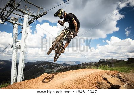 Mt Buller, Australia - January 4, 2017: Downhill mountain bike riders attempt the ABOM and International tracks on January 4, 2017 in Mt Buller, Australia