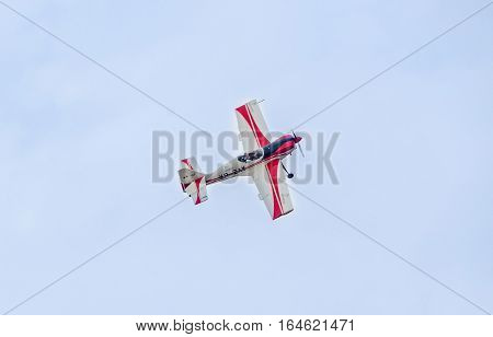 Bucharest, Romania - July 30, 2016. Pilot With His Colored Airplane Training In The Blue Sky.  Bucha