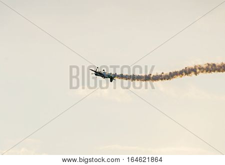 Bucharest, Romania - July 20, 2016. Airplane With Colored Trace Smoke Flying In The Blue Clouds Sky,