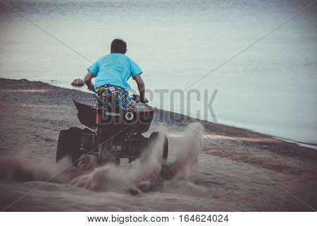 sport ATV on the beach of Ladoga lake, Karelia, Russia