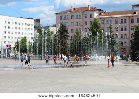 PERM RUSSIA - JUN 16 2016: Happy children play with dry fountain New light and music fountain in Perm was opened in 2015