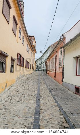 Sibiu, Romania - August 10, 2016: The Paved Streets Near Downtown Of The City. Colored Houses.