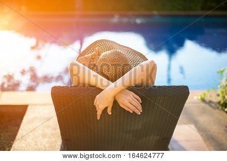 Women relaxing near luxury swimming pool, so happy