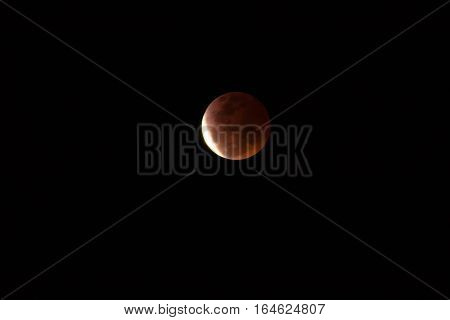 The orange moon in the dark night time