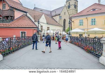 Sibiu, Romania - August 10, 2016: Liars Bridge Near Downtown With Old Colored Houses.