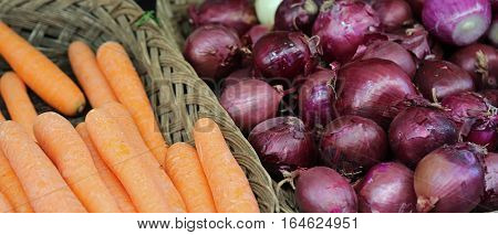 Orange Carrots And Red Onions For Sale