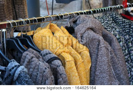 Used Clothes Winter Clothes Hung On Hangers For Sale