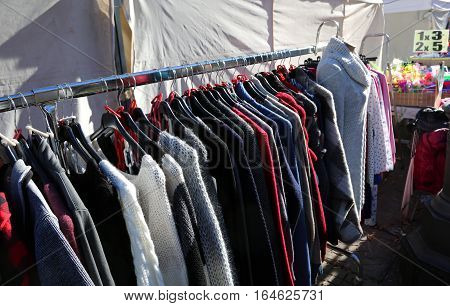 Many Winter Clothes On Hangers For Sale