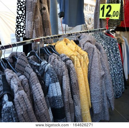 Winter Clothes Hung On Hangers For Sale At The Flea Market