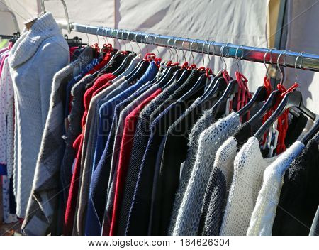 Winter Clothes On Hangers For Sale In The Outdoor Market