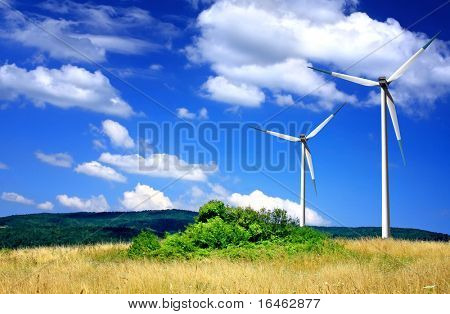 Wind turbines on cloudy sky