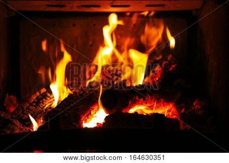 Burning pieces of wood in Fireplace. Stock photo