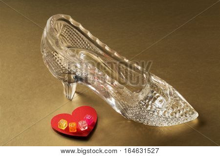 Crystal shoe and red heart with the word love