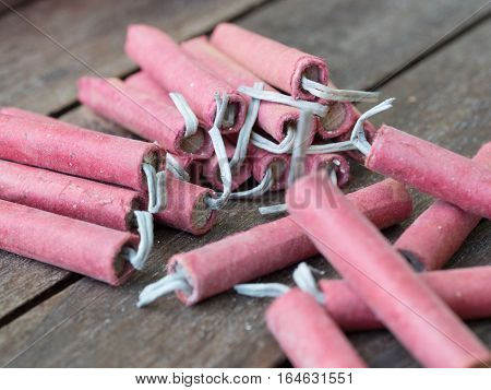 stack of red firecrackers on wooden table