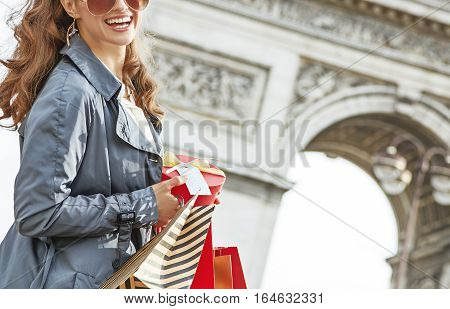 Happy Woman With Christmas Present Near Arc De Triomphe In Paris