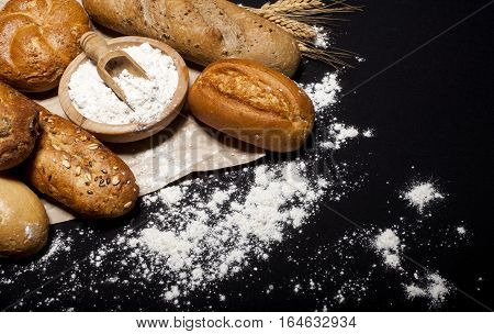 Assortment Of Baked Goods On Black Table