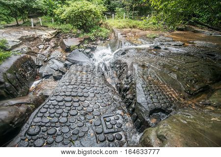 Kbal Spean waterfall the mystery place of ancient Khmer empire in Siem Reap, Cambodia.