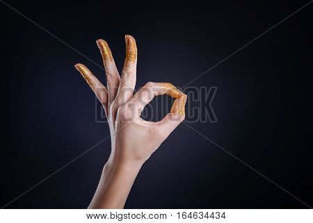Everything will be ok.Close up of slim hand gesturing positive sign