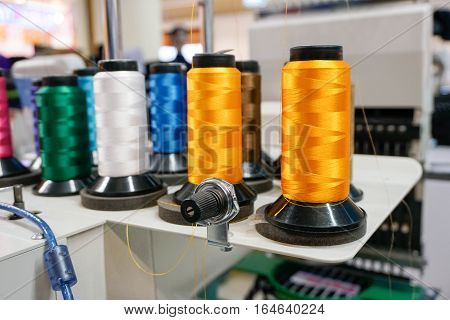 Colorful Threads on Sewing Machine. Embroidery process
