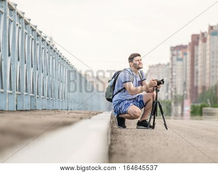 Man With Camera On Tripod