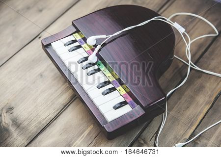 Piano keyboard with headphones for music table