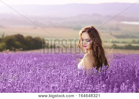 Beautiful Young Woman Portrait In Lavender Field. Attractive Brunette Girl With Long Healthy Hair St