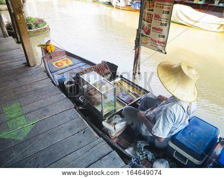 Woman selling food at Pattaya Floating Market. February 5 2013 - Pattaya Thailand