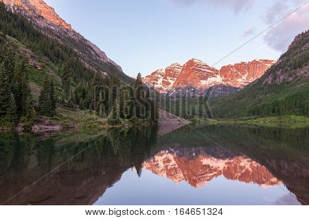 a reflection of the scenic landscape of the maroon bells Aspen Colorado at sunrise