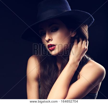 Beautiful Sexy Female Model With Long Brown Hair Posing In Cowboy Hat And Fashion Top Dark Backgroun