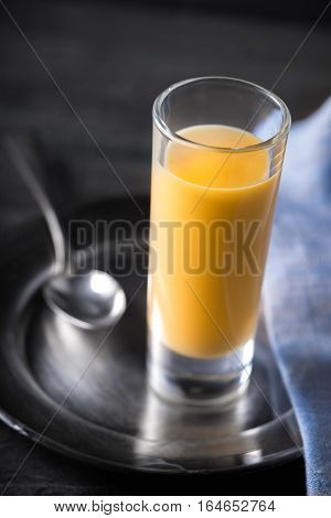 Liqueur Advocaat on the dark background, top, view