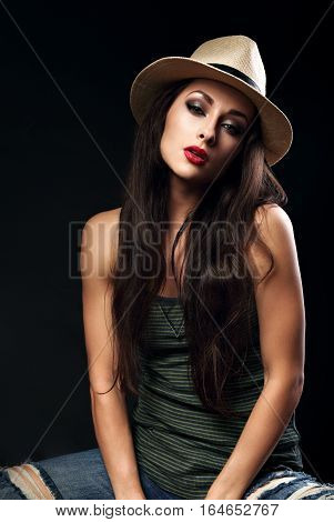 Beautiful Sexy Female Model With Long Brown Hair Posing In Cowboy Summer Hat And Fashion Top And Rip