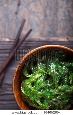 Chuka salad in the wooden bowl background, top, view