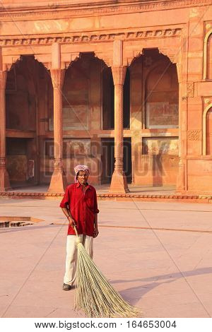 Agra, India - November 7: Unidentified Man Sweeps Courtyard Of Jahangiri Mahal In Agra Fort On Novem