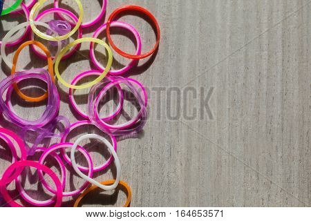 colored rubber bands on wooden background conceptual idea copyspace