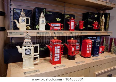 London UK - June 11 2010: Traditional city souvenirs in form of Big Ben post box telephone box or the red bus are exposed in the store of London.