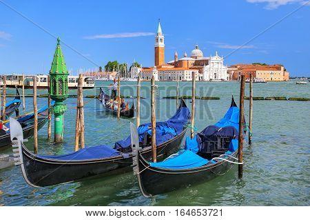 Venice, Italy - June 21: Gondolas Moored Near San Marco Square Across From San Giorgio Maggiore Isla