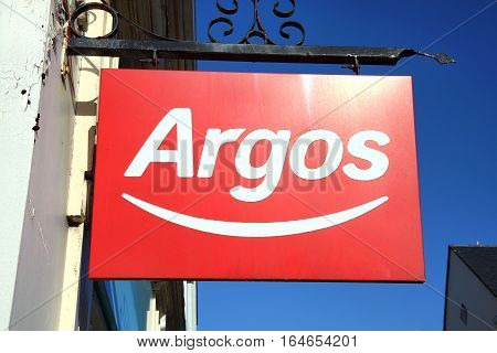 Carmarthen, Wales, UK - January 2, 2017:  Argos logo advertising sign outside its retail supermarket stores in the city centre