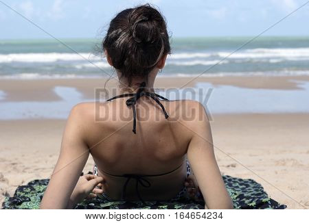 Young teenager girl in relax pose with beach behind in northeast Brazil