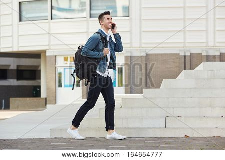 Laughing Man On Mobile Phone Call Walking Outside