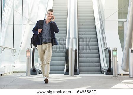 Fashionable Happy Man On Phone Call By Escalator