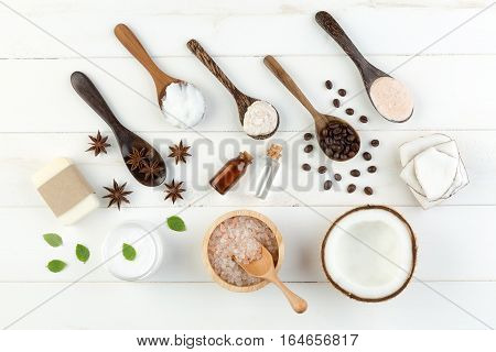 Homemade Coconut Products On White Wooden Table Background. Oil, Scrub, Soap, Milk, Lotion, Mint Him