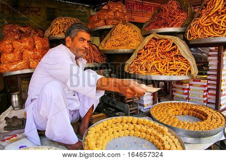Amber, India - November 13: Unidentified Man Sells Snacks Near Amber Fort On November 13, 2014 In Am