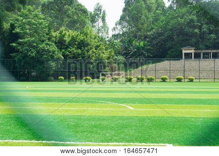 goal of a soccer field behind the fence