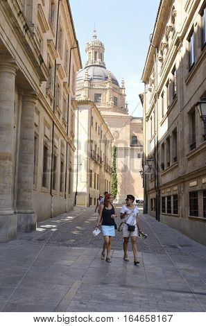 SALAMANCA, SPAIN - AUGUST 3, 2016: Street near the cathedral in Salamanca Spain.