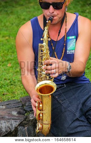 Colonia, Uruguay - December 7: Unidentified Man Plays Saxophone On December 7, 2014 In Colonia Del S