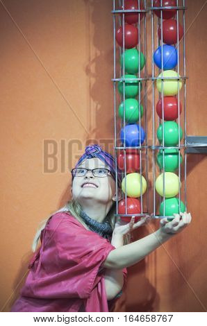 LAS VEGAS, NEVADA, DECEMBER 29. The Discovery Children's Museum on December 29, 2016, in Las Vegas, Nevada. A Girl Plugs the Ball Shoot at the Discovery Children's Museum in Las Vegas, Nevada.