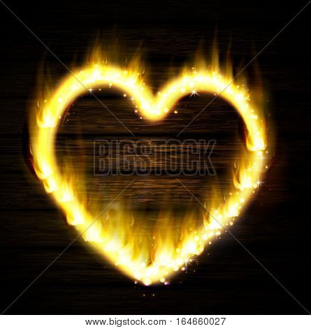 Flame heart on the dark wooden background
