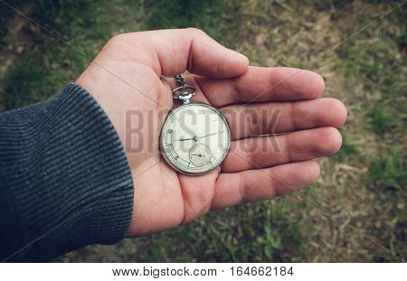 Vintage pocket watch in a man's hand