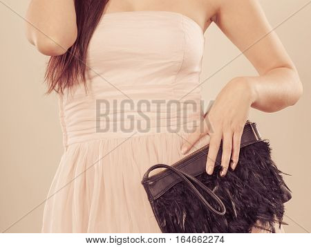 Woman In Bright Dress With Clutch Bag