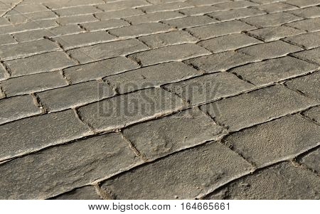 Stamped concrete pavement outdoor, mimics cobblestones pattern, flooring exterior, decorative appearance colors and textures of paving cobble stone perspective